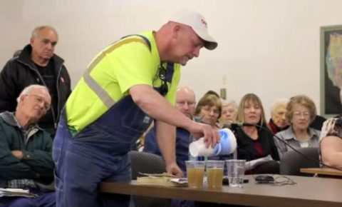 Watch As This Farmer Asks Oil & Gas Commissioners To Drink Fracking Water